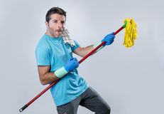Domestic service man or happy husband cleaning home playing with Stock Photo