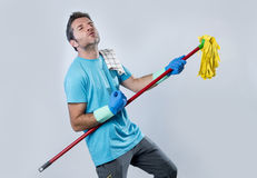 Domestic service man or happy husband cleaning home playing with Royalty Free Stock Photos