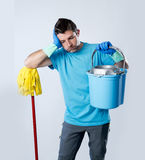 Domestic service man or stressed husband housework washing holdi Royalty Free Stock Photos