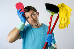 Domestic service man or stressed husband housework washing with sponge mop and broom. Portrait young domestic service cleaner man or stressed husband doing Royalty Free Stock Photography