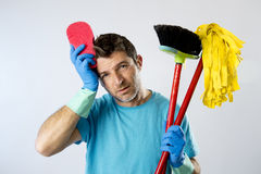 Domestic service man or stressed husband housework washing with sponge mop and broom. Portrait young domestic service cleaner man or stressed husband doing Stock Photography