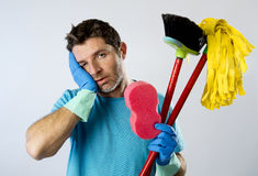 Domestic service man or stressed husband housework washing with sponge mop and broom. Portrait young domestic service cleaner man or stressed husband doing Stock Image