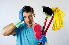 Domestic service man or stressed husband housework washing with sponge mop and broom Royalty Free Stock Images