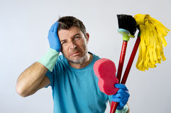 Domestic service man or stressed husband housework washing with sponge mop and broom Stock Images