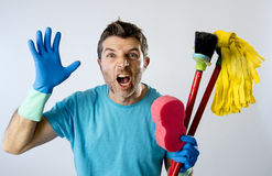 Domestic service man or stressed husband housework washing with sponge mop and broom. Portrait young domestic service cleaner man or stressed husband doing Royalty Free Stock Images