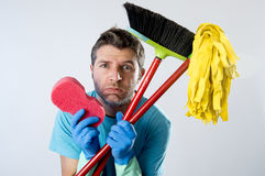 Domestic service man or stressed husband housework washing with sponge mop and broom. Portrait young domestic service cleaner man or stressed husband doing Stock Photos
