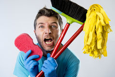Domestic service man or stressed husband housework washing with sponge mop and broom. Portrait young domestic service cleaner man or stressed husband doing Stock Images