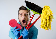 Domestic service man or stressed husband housework washing with sponge mop and broom. Portrait young domestic service cleaner man or stressed husband doing Royalty Free Stock Photos