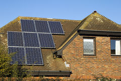 Domestic solar panels. Solar panels catching the sun's rays on private home Stock Image