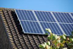 Domestic Solar panels 2. Electricity-generating solar panels on a domestic UK property Stock Images