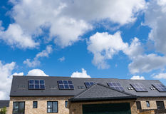 Domestic solar panels on the rooftop of newly built houses Stock Photo