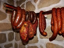 Domestic Traditional Smoked Sausage and Ham Royalty Free Stock Photo