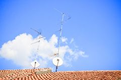 Domestic TV and Radio Aerials on the roof Royalty Free Stock Photos