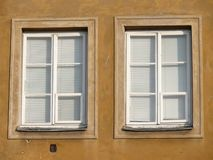 Domestic violence. Close up of two windows with lowered white blinds Stock Photo