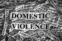 Domestic violence. Torn pieces of paper with the words . Concept Image. Black and White. Closeup stock image