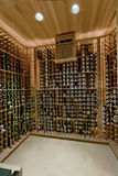 Domestic Wine Cellar. View of racks with winebottles at domestic wine cellar Stock Photography