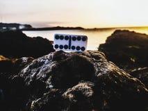 Dominó en las rocas Foto de archivo libre de regalías