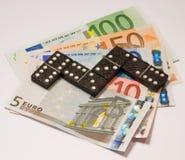 Dominó financeiro Imagens de Stock