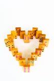 Dominós de madera del corazón aislados Imagen de archivo