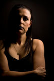 Dominance. Strong woman poised with a serious face wearing black Stock Images
