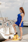 Dominant feminist woman wearing high heels in marina Stock Images