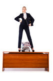 Dominant woman boss on desk. Dominant woman boss standing on desk royalty free stock photo
