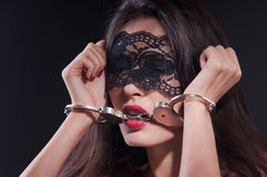 Dominating beauty in handcuffs Stock Photos