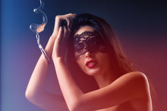 Dominating beauty in handcuffs Royalty Free Stock Image