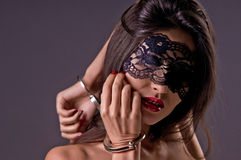 Dominating beauty in handcuffs Royalty Free Stock Images
