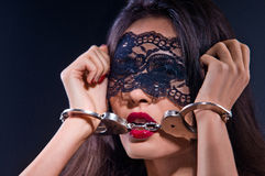 Dominating beauty in handcuffs Stock Photography