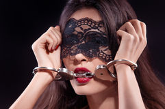 Dominating beauty in handcuffs Stock Images