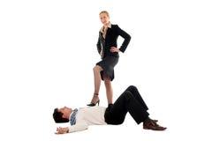 Dominating businesswoman. Businesswoman dominating businessman, over white background stock photos