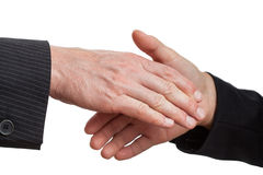 Dominating handshake Stock Images