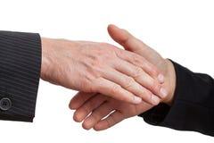 Dominating handshake Stock Images