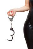 Dominatrix holding handcuffs Stock Photos