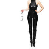 Dominatrix holding handcuffs Royalty Free Stock Photos