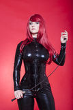 Dominatrix with riding crop Royalty Free Stock Photo