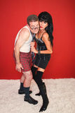 Dominatrix and Scared Man. A beautiful dominatrix pulls on her fearful client's necktie Stock Photos
