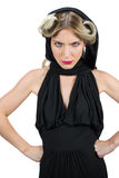 Domineering creepy blonde wearing black clothes frowning. While posing on white background stock photos