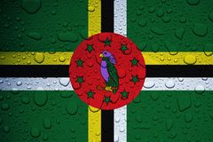 DOMINICA, CARIBBEAN, 23 September 2017 - Hurricane Maria leaves island under water. World weeps. Illustrative editorial image of flag and rain drops Stock Image