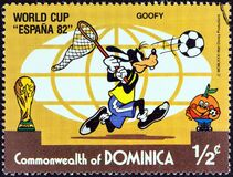 DOMINICA - CIRCA 1982: A stamp printed in Dominica shows Goofy chasing ball with butterfly net, circa 1982.