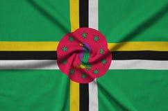 Dominica de vlag wordt afgeschilderd op een stof van de sportendoek met vele vouwen De banner van het sportteam royalty-vrije stock afbeelding