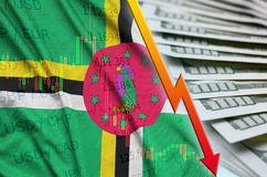 Dominica flag and chart falling US dollar position with a fan of dollar bills. Concept of depreciation value of US dollar currency stock images