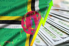 Dominica flag and chart growing US dollar position with a fan of dollar bills. Concept of increasing value of US dollar currency royalty free stock images