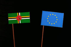 Dominica flag with European Union EU flag isolated on black. Background Royalty Free Stock Images