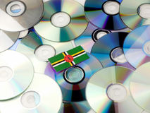 Dominica flag on top of CD and DVD pile isolated on white. Dominica flag on top of CD and DVD pile isolated Stock Photo