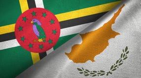 Dominica i Cypr dwa flagi tekstylny płótno, tkaniny tekstura zdjęcia stock