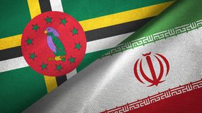 Dominica and Iran two flags textile cloth, fabric texture. Dominica and Iran flags together textile cloth, fabric texture stock photos