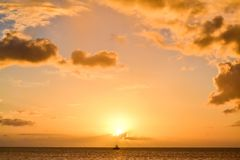 Dominica Island Sunset in Silhouette. Dominica island sunset with a beautiful horizon of blue and yellow and orange colors stock photo