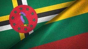 Dominica and Lithuania two flags textile cloth, fabric texture. Dominica and Lithuania flags together textile cloth, fabric texture royalty free stock photos